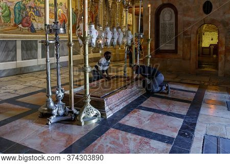 Jerusalem, Israel, June 13, 2020 : Believer Men Kneel And Pray In The Church Of The Holy Sepulchre I
