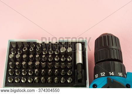 A Screwdriver With A Battery And A Set Of Bits For It