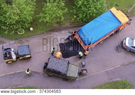 Moscow 15/05/2020 Workers Repair Asphalt Around Sewer Hatch On The Road, Patch Repair By Municipal C