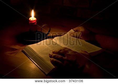 Reading The Bible By Candle Light