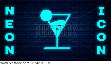 Glowing Neon Martini Glass Icon Isolated On Brick Wall Background. Cocktail Icon. Wine Glass Icon. V
