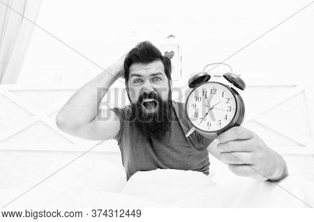Get Up Right Now. What Time Is It. Stressed Man Alarm Clock. Sleepy Man Holding Alarm Clock In Bed.