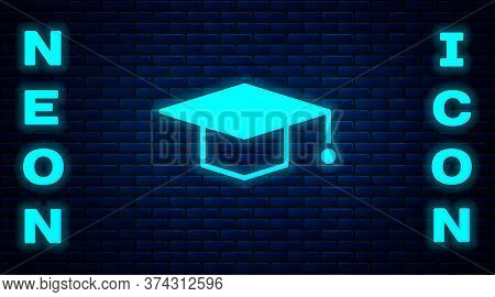 Glowing Neon Graduation Cap Icon Isolated On Brick Wall Background. Graduation Hat With Tassel Icon.