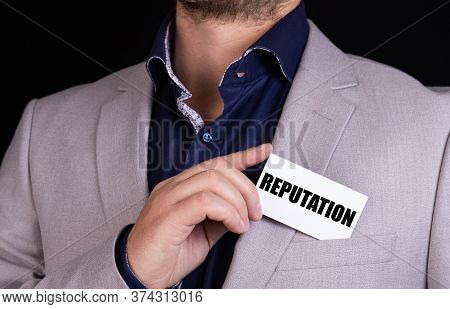 Reputation Text On The Blackboard Is Written On The Card That The Businessman Put In His Jacket Pock