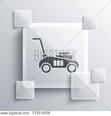 Grey Lawn Mower Icon Isolated On Grey Background. Lawn Mower Cutting Grass. Square Glass Panels. Vec