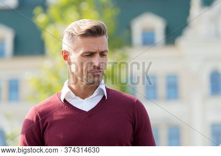Being Slightly Upset. Bachelor. Calm And Confident Man Looking Down. Handsome Sexy Man Outdoor. Mode