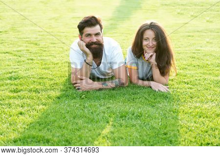 We Are Dating. Happy Couple Relax On Green Grass. Couple In Love Summer Outdoors. Sexy Couple In Cas
