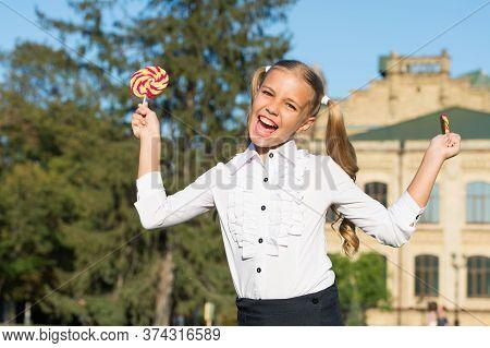 Toothsome Dessert. Happy Dessert Girl Hold Lollipops. Little Child Enjoy Dessert Summer Outdoors. De