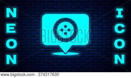 Glowing Neon Location Tailor Shop Icon Isolated On Brick Wall Background. Vector Illustration