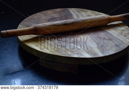 Picture Of Flat Circular Wooden Rolling Board With Rolling Pin
