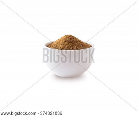 Heap Of Coconut Sugar Isolated On White Background. Heap Of Coconut Sugar On White. Dark Sugar Isola