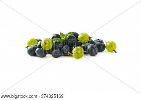 Berry Isolation. Green And Blue Berries Isolated On White Background. Gooseberry And Blueberry With