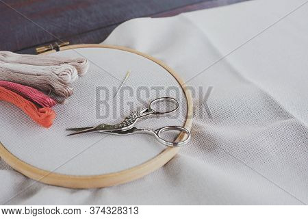 Canvas For Embroidery With A Cross Embroidered In A Round Wooden Hoop, Multi-colored Thread Mouline