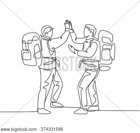One Line Drawing Of Two Young Happy Tourist Carrying Backpack To Go To Holiday And Gives High Five G