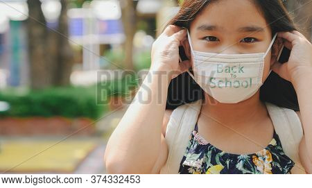 Back To School. Asian Child Girl Wearing Face Mask With Backpack  Going To School .covid-19 Coronavi