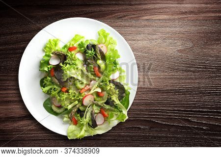 Directly Above Shot Of Plate Of Fresh And Healthy Salad On Wooden Background