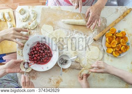 Preparing Of Homemade Sweet Dumplings With Fruits, Home Dinner Cooking, Hands Of Family Members, Rea