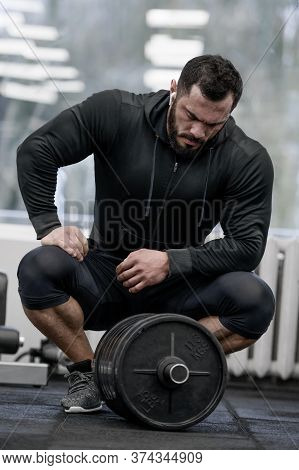 Crossfit Heavy Workout Training By Young Bearded Strong Male In Black Hoodie Sitting Relaxing With I
