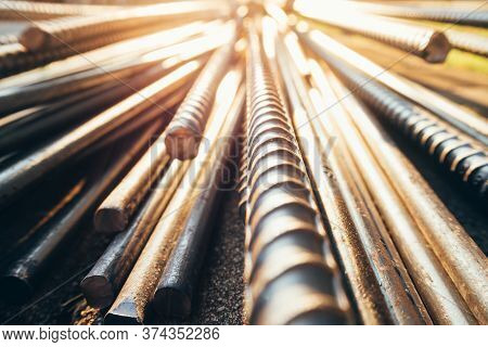 Close Up Steel Bar Or Steel Reinforcement Bar In The Construction Site With Sunbeam At The Morning,