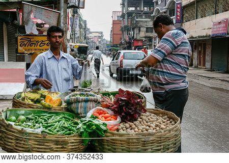 Kolkata, India - September 24, 2019 : Vendor Indian Man Selling Local Fresh Vegetable And Fruit (pot