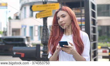 Independent Concept. Indie Women Are Playing Phones In The City. 4k Resolution.