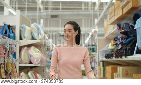 Shopping Concept. The Girl Is Walking To Shop At The Clothing Department. 4k Resolution.