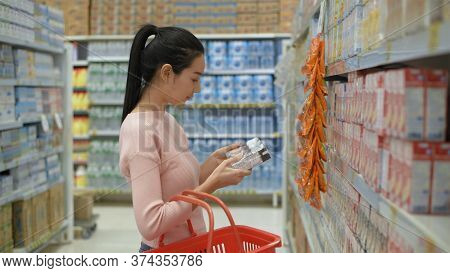 Shopping Concept. An Asian Woman Is Buying Box Milk At The Drink Department. 4k Resolution.