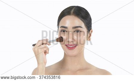 Beauty Concept. An Asian Woman Is Makeup With A Brush. 4k Resolution.