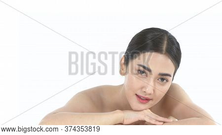 Beauty Concept. An Asian Woman Smiling On A White Background. 4k Resolution.