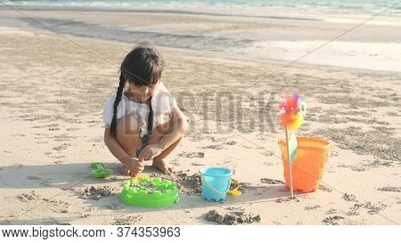 Family Concept. Children Making Sand Playing On The Beach. 4k Resolution.