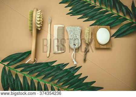 Flat Lay Eco Friendly Spa Kit, Massage Brush, Bamboo Toothbrush, Pumice, Wooden Comb, Natural Soap,