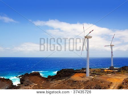 Aerogenerator windmills in front of ocean sea at Canary Islands