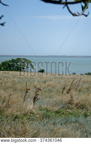 Budzhak Steppe Under Beautiful Sky. Blue Sky With White Clouds Over The Summer Steppe And Estuary In