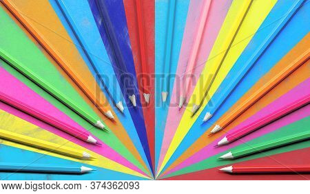 Colored Pencils Top View Arranged In A Row As A Fan. Multicolor Drawing. Rainbow Drawing With Wooden