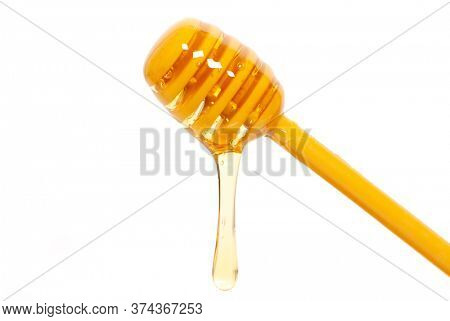 honey dipper with a drop of bee honey