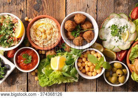 assorted of lebanese-  samosa, pita bread, chickpea, hummus