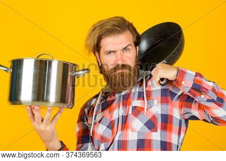Kitchenware. Cooking Vessels. Kitchen Advertising. Bearded Man With Saucepan And Frypan. Man Chef Wi