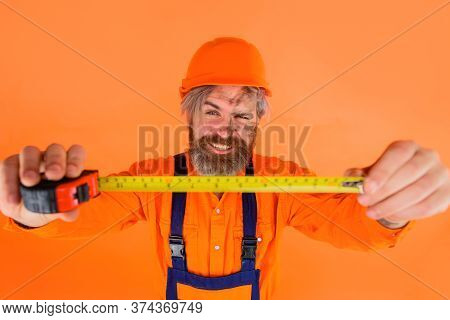 Builder With Measure Tape. Selective Focus. Measuring Device. Construction Worker. Worker Use Tape M