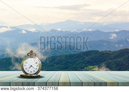 Old Pocket Watch On The Wooden Balcony Floor Is Natural As Backdrop.