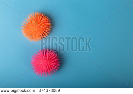 Coronaviruses Or The Other Infectious Microbes Of Orange And Pink Color Sit Near Each To Other Isola
