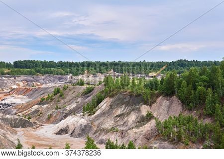 Multi-colored Clay Hills And Ravines On The Site Of An Old Kaolin Quarry, The Excavator Is Visible I