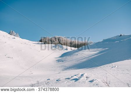 Snow-covered Gorge In The Mountains. Snow-covered Forest In A Ravine, In The North Of Montenegro, In