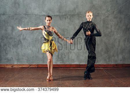 Young Couple Dancers Dancing Ballroom Dance Cha-cha-cha.