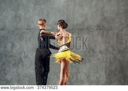 Young Couple Dancers Dancing Ballroom Dance Cha Cha Cha.