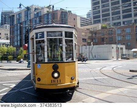 San Francisco - June 26, 2009: Orange Historic Streetcar O. 1811 Milan, Italy (original 1928 Livery)