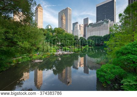 New York, New York, USA Central Park South skyline from Central Park in the summertime.
