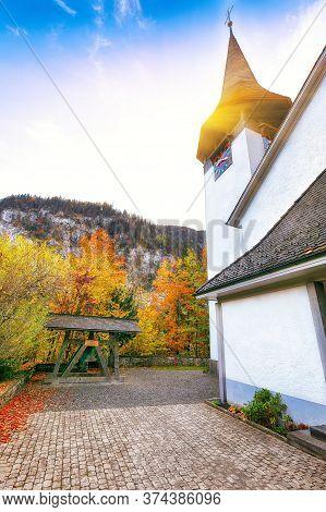 Captivating Autumn View Of Lauterbrunnen Church .  Location: Lauterbrunnen Village, Berner Oberland,