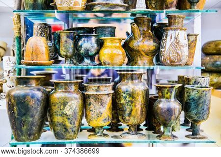 Luxor, Egypt - Jan 28, 2020: The numerous souvenirs at the tourist stall in Luxor. Egypt.