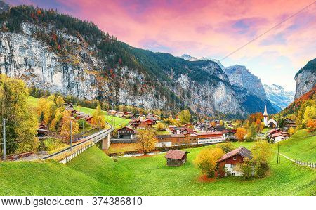 Astonishing Autumn View Of Lauterbrunnen Valley With Gorgeous Staubbach Waterfall And Swiss Alps In
