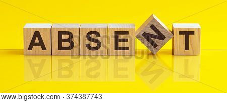 Absent The Word Is Written On A Wooden Block. The Image Is Mirrored In The Glossy Surface. For Your